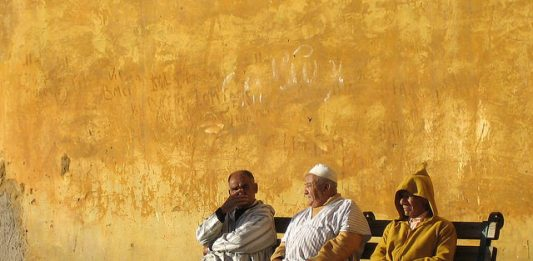 Moroccan men sitting. Photo by Flickr/Carlos ZGZ
