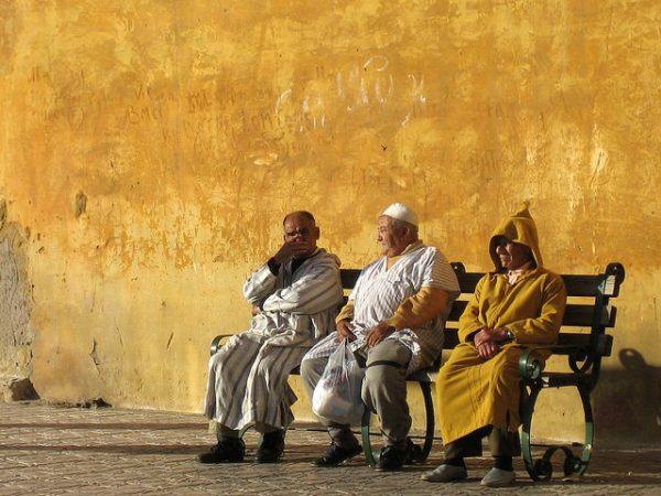 Moroccan men sitting. Photo by Flickr/Carlos ZGZ