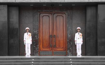 Two sentries guard the entrance to the Ho Chi Minh Mausoleum, Ba Dinh Square, Hanoi, Vietnam. Photo by Flickr/joolsgriff