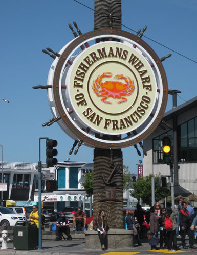 With its many alluring tourist options, Fisherman's Wharf is an iconic San Francisco attraction where crab vendors purvey walk-away crab and shrimp cocktails. Photo by Pat Woods