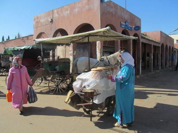 café, the women do the shopping or act as the family entrepreneurs. Photo by Carol Bowman