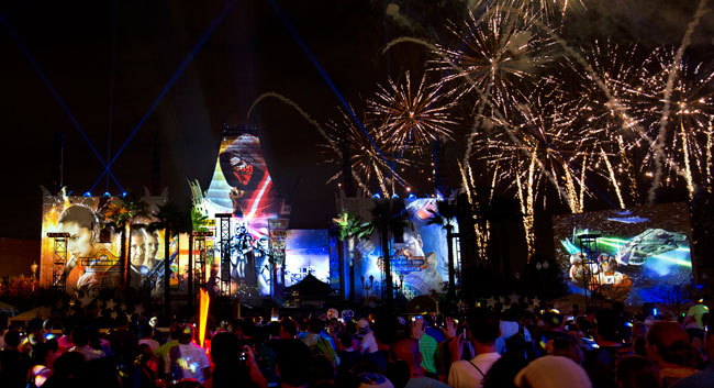 "The new nightly Star Wars fireworks show, ""Star Wars: A Galactic Spectacular,"" combines fireworks, pyrotechnics, special effects and video projections to turn familiar buildings into Star Wars scenes. Photo by Gregg Newton"
