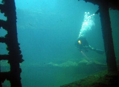Diver in the hold of the Sankisan Maru, a freighter that once carried aircraft. Flickr/Matt Kieffer