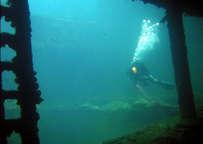 Diving Chuuk - Diver in the hold of the Sankisan Maru, a freighter that once carried aircraft. Flickr/Matt Kieffer