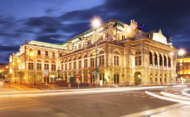 The Vienna Opera House at night.