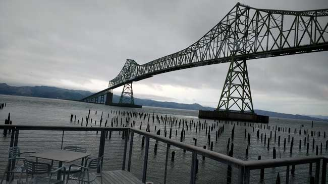 Astoria-Megler Bridge connecting Washington and Oregon, notice wooden posts remnants of canneries along the Columbia River. Photo by Debbie Miller PondAstoria-Megler Bridge connecting Washington and Oregon, notice wooden posts remnants of canneries along the Columbia River. Photo by Debbie Miller Pond