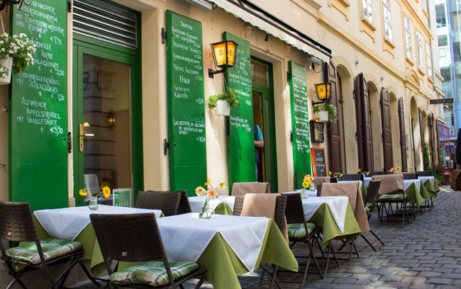 Outdoor patios line the streets in Vienna. Photo by Janna Graber