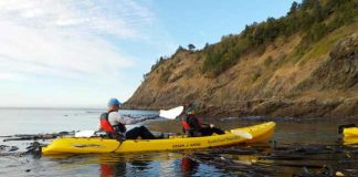 The author and her husband kayaking in Port Orford. Photo by South Coast Tours, LLC