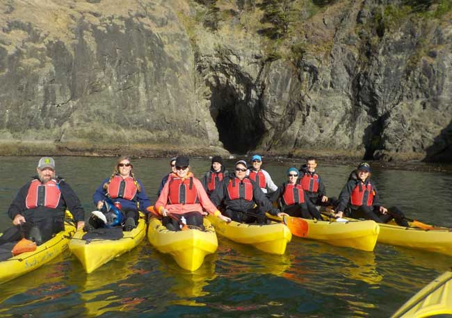 Sea kayaking with South Coast Tours LLC in Port Orford, OR. Photo by South Coast Tours