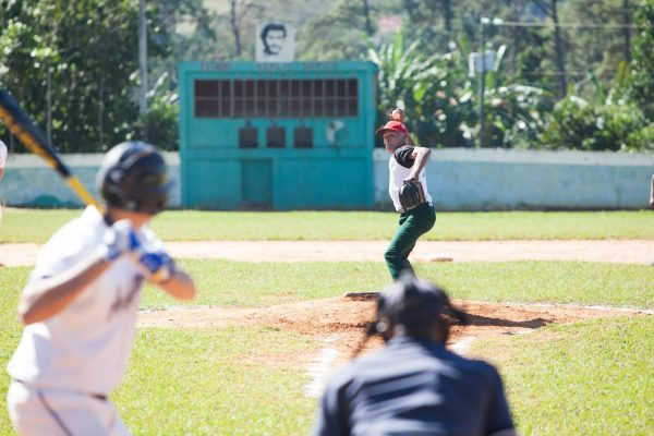 Baseball in Cuba - Cuban players and a team of former Amherst College baseball players during a game. Photo by Rob Born.