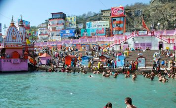 In the Ganges for Kumbh Mela. Photo by Rafaela Schneider
