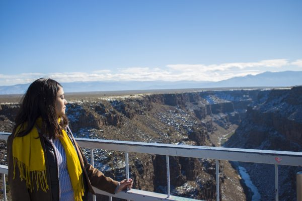 Gabriela Rodriguez holds onto the railing as she looks out over the Rio Grande Gorge.