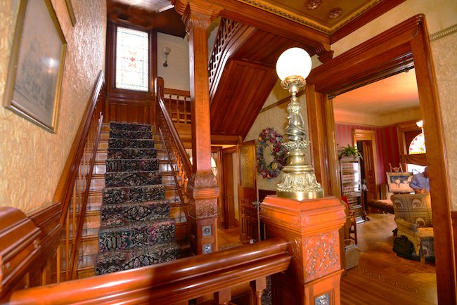 Staircase showing rich woodcarvings, photo courtesy of Nagle Warren Mansion