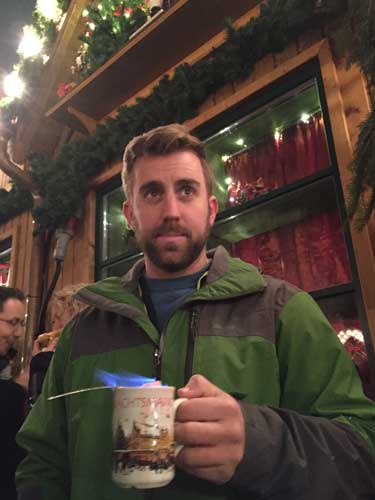 Ben tries feuerzanbowle, a hot drink made with mulled wine and rum which is lit on fire. Photo by Janna Graber