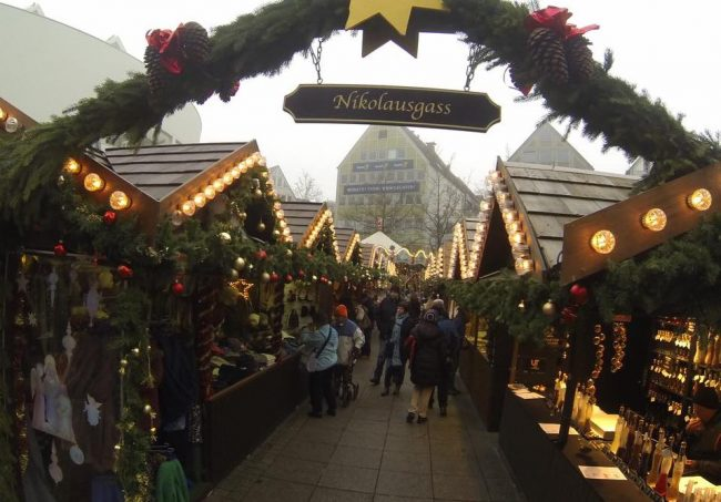 "The large Christmas market in Ulm, Germany features little ""streets"" of wooden stalls selling food, handmade craft and Christmas items. Photo by Janna Graber"