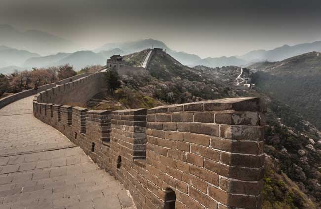 Travel to the Great Wall of China. The Great Wall of China is the largest man-made structure in the world. Flickr/BRJ INC.