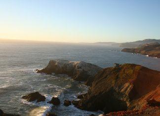 The sun sets along the shoreline in Marin County, California. Flickr/Colin Arthur