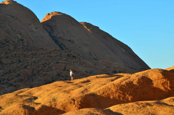 Namibia Travel - Walking on the mars-like mountains of Spitskoppe. Photo by Emma Strumpman