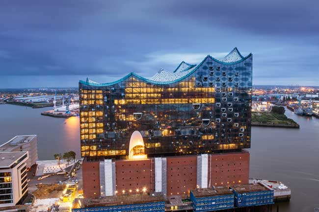 The Elbphilharmonie in Hamburg is surrounded by water on three sides. Photo by Hamburg Tourism, Thies Raetzke