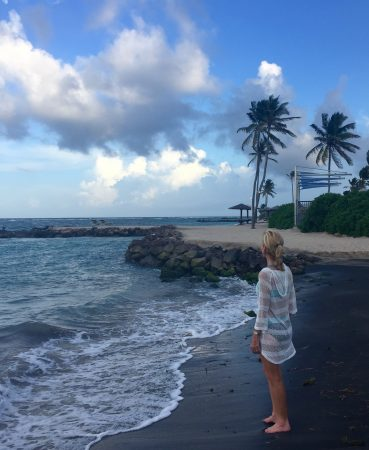 Nevis beaches -- The author at one of the islands beautiful beaches. Photo courtesy Janna Graber