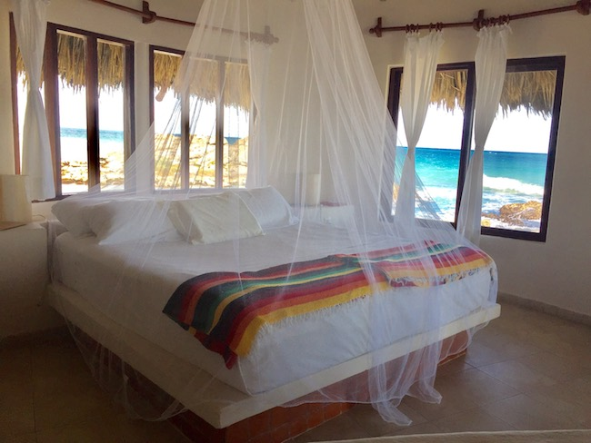 All beds have netting; windows are the only thing between you and the ocean. Photo by Claudia Carbone