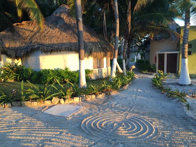 Pathway with labyrinths, a Mayan sacred symbol, etched in the sand at Maya Tulum. Photo by Claudia Carbone