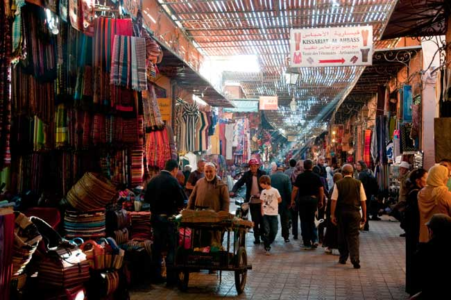 Walking through the Marrakech souk. Photo by Moroccan National Office of Tourism