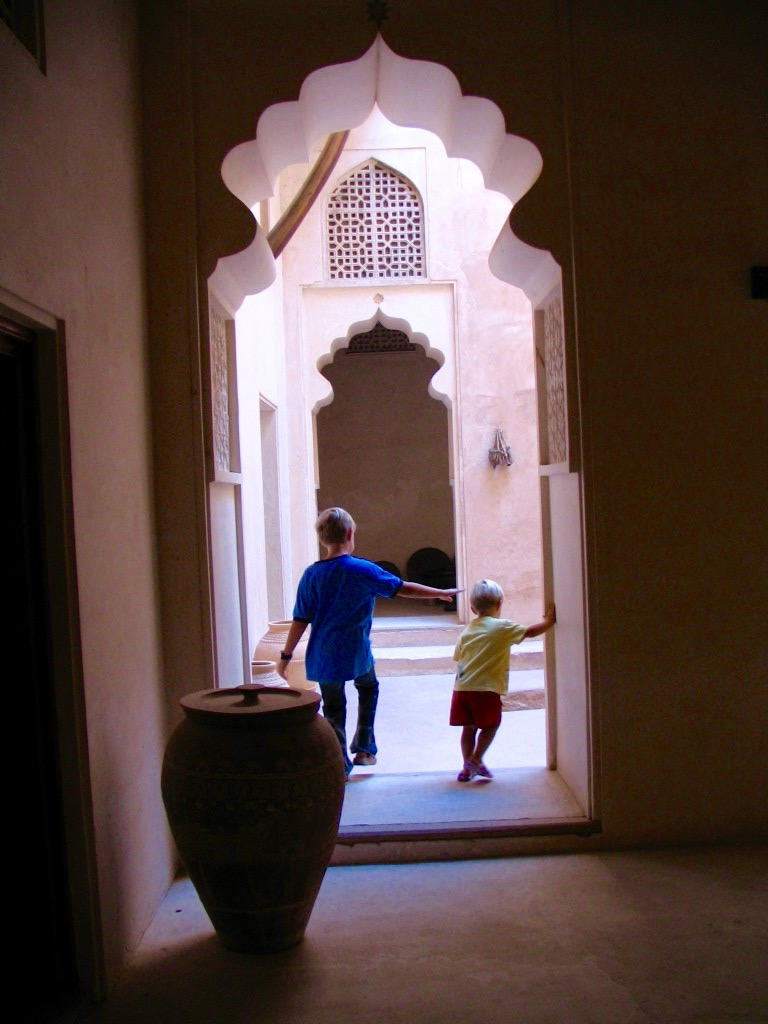 Oman Travel - Adam and Nicholasat at Taqah Castle. Photo by Paula Ebelher