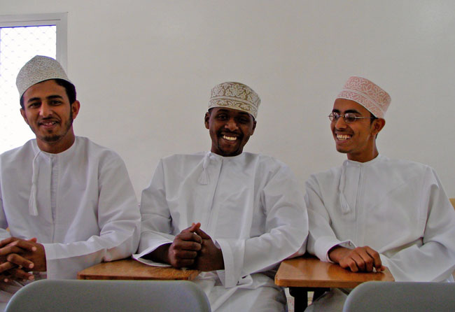 Three Omani boys in traditional dishdashas, taken at the Salalah College of Technology. Photo by Chris Brauer