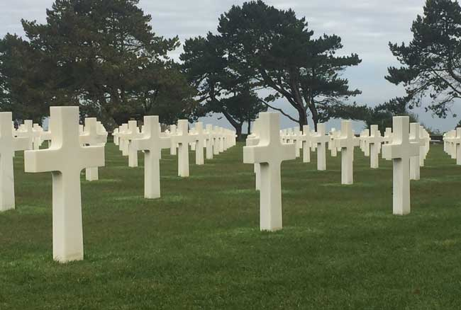 Rows of gravestones at the American Cemetery in Normandy. Photo by Janna Graber