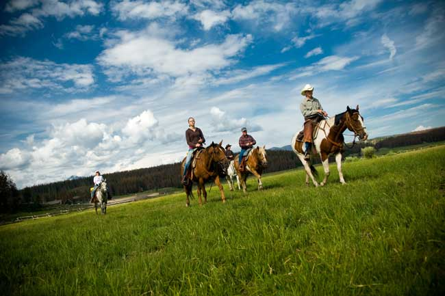 Best Year-Round Colorado Dude Ranches. Guests enjoy an afternoon ride at Devil's Thumb Ranch in Colorado. Photo courtesy Devil's Thumb Ranch