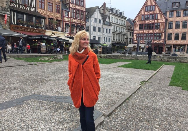 Exploring Rouen, France, and wearing the French coat I purchased in Honfleur. Photo courtesy Janna Graber