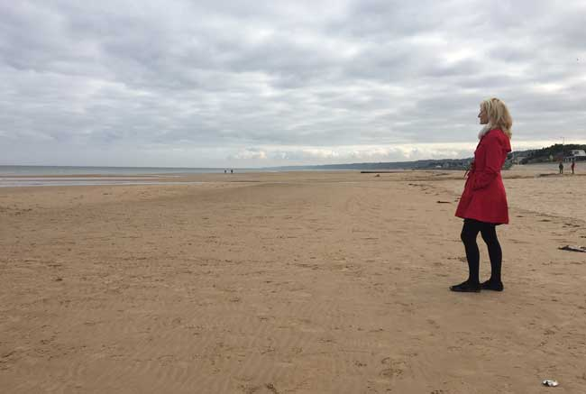 Contemplating the past at Omaha Beach in Normandy. Photo courtesy Janna Graber