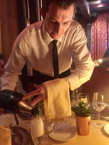 Service with flair at La Couronne in Rouen, France. Photo by Janna Graber