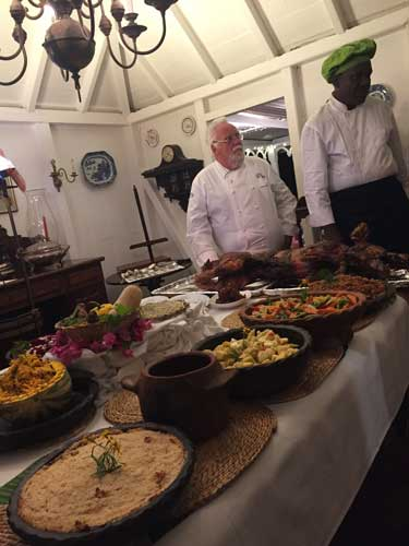 Preparing for the West Indian Pig Roast and Buffet at Hermitage Plantation on Nevis. Photo by Janna Graber