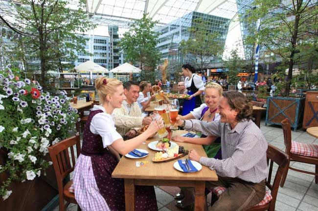 The Munich Airport has its own brewery and beer garden. During the holidays, the airport also hosts a Christmas market and ice skating rink. Photo courtesy Munich Airport