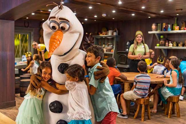 Olaf greets young guests at Frozen Adventures on the Disney Wonder. Photo by Matt Stroshane