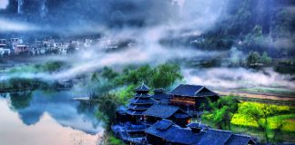 A misty village along the Li River. Photo by Harvey Thomlinson
