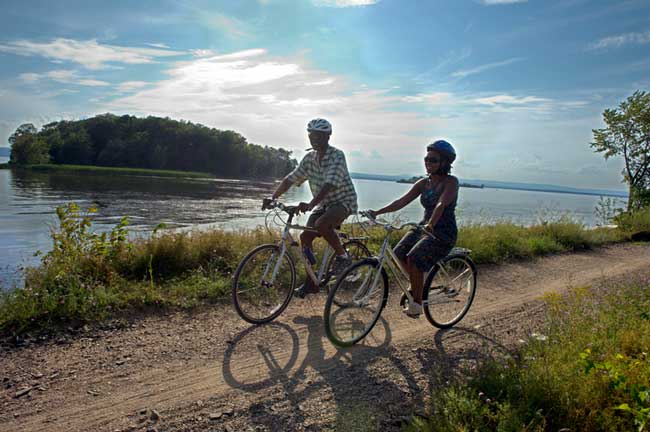 Travel in Vermont means biking along Lake Champlain. Photo by Vermont Tourism