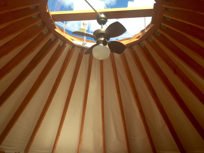 Plexiglass dome and fan provide light and air for the yurt. Photo by Claudia Carbone