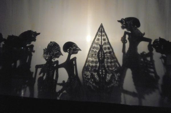 The shadow puppets behind the opaque screen entertain the viewing audience. Photo by Carol L. Bowman