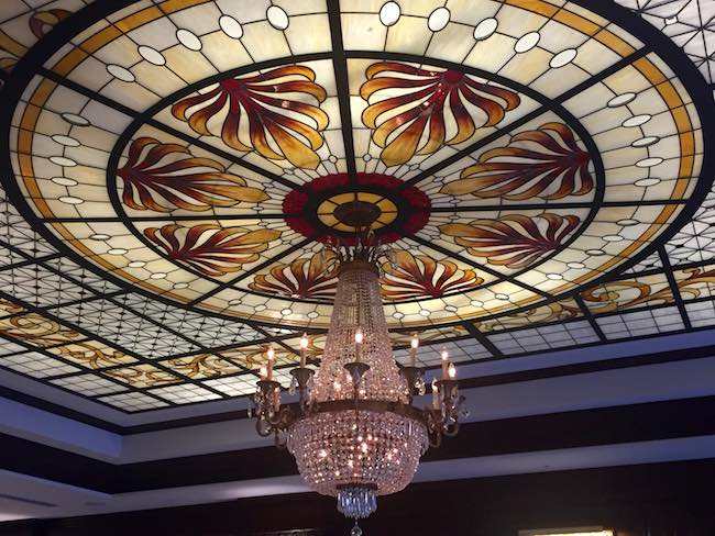 Ceiling and chandelier in lobby of west building. Photo by Claudia Carbone