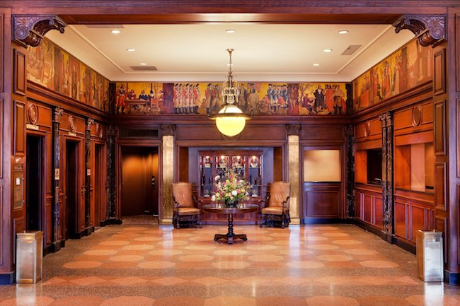 Lobby check-in with original murals depicting colonial Virginia. Photo courtesy of Hotel Roanoke