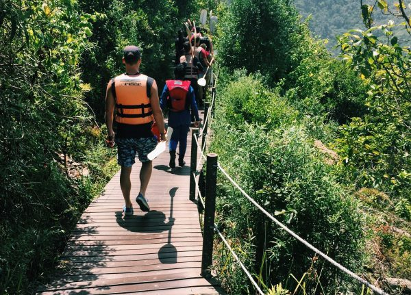 To reach our point of departure, we followed our guides on a short 20-minute hike, where we had to navigate steep flights of wooden steps while brandishing white paddles. Photo by Emma Strumpman
