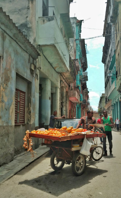 Cuba: A vendor sells fruit in the street. Photo by Christina Lyon