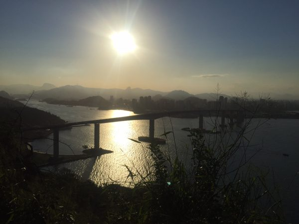 View of the Third Bridge (Portuguese: Terceira Ponte) at sunset. The bridge connects Vitoria to the neighboring twin city of Vila Velha. Photo by Mark Blank