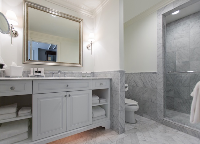 All-white marble bathroom. Photo courtesy of Belmond Charleston Place