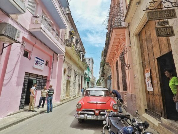 Havana is a lively city where the streets are filled with classic cars and locals socializing. Photo by Christina Lyon