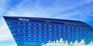 The tents of the DIA terminal are reflected in the glass windows of the Westin Hotel. Photo courtesy of Westin DIA