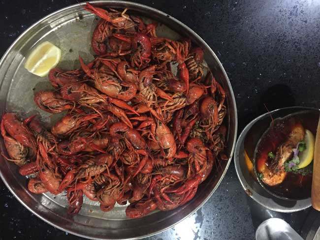 Crawfish boil at Deanie's Seafood Restaurant and Market in New Orleans. Photo by Janna Graber